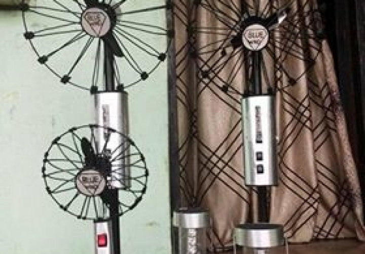 PICTURES: Meet Nigerian Who Produces Rechargeable Standing Fan That Last Up To 12Hours